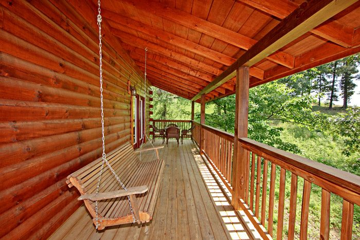 Cabin with Porch Swing - A Daze End