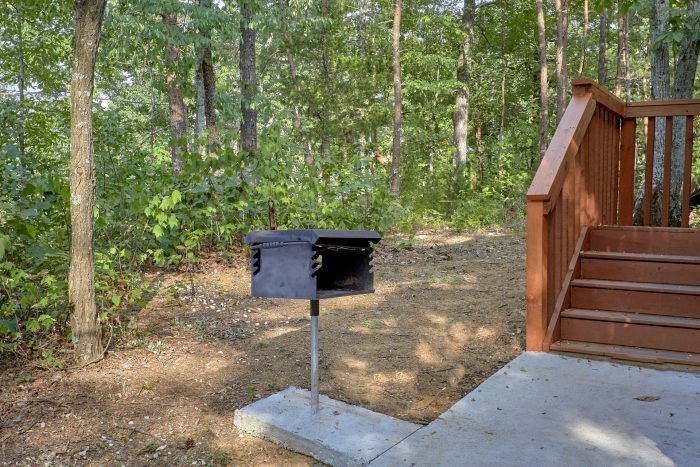 Charcoal Grill and Paved Driveway - A Stones Throw