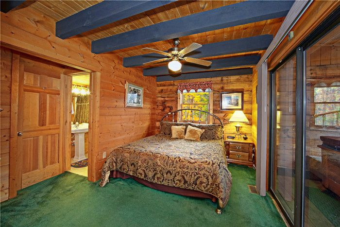 Bedroom with Access to Outdoor Hot Tub - Caliente Cabin