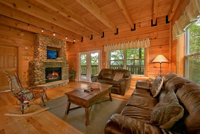 Cabin with stone fireplace and living room - Catch A Star
