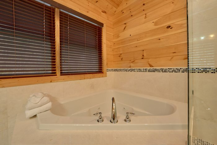 Private Jacuzzi Tub in Master Bathroom in Cabin - Charming Charlie's Cabin