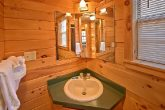 Cabin with bath vanity and mirrors