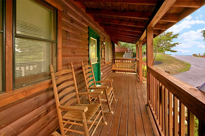 Cabin with rocking chairs and resort pool - Country Comfort
