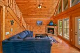 Cabin with large living area and fireplace