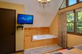 Cabin with Private jacuzzi tub and TV in Bedroom