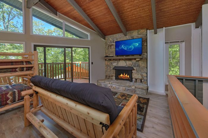 Cabin with Stone Fireplace and 2 TVs in Loft - Forever Country