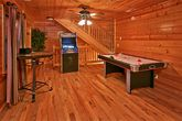 Cabin with arcade game and air hockey game