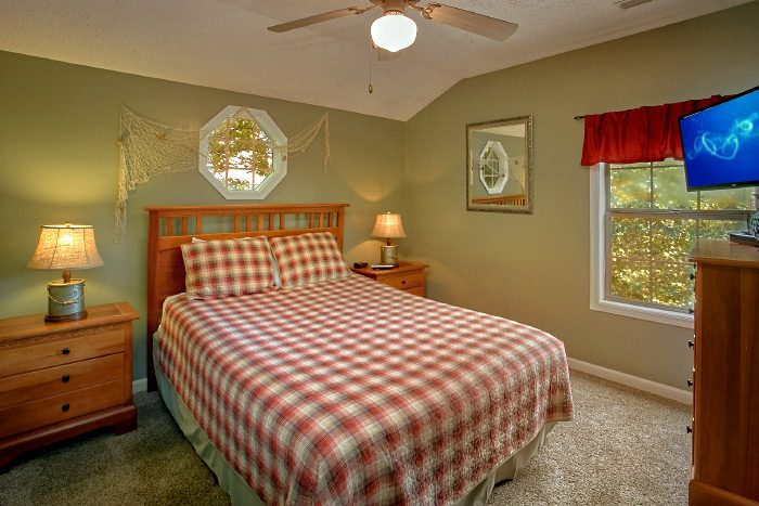Queen Bedroom Furnished with Flat Screen TV - Kickin Back