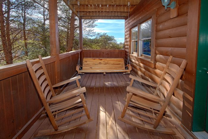 Deck with Porch Swing at Cabin - Lil Cajun Cabin