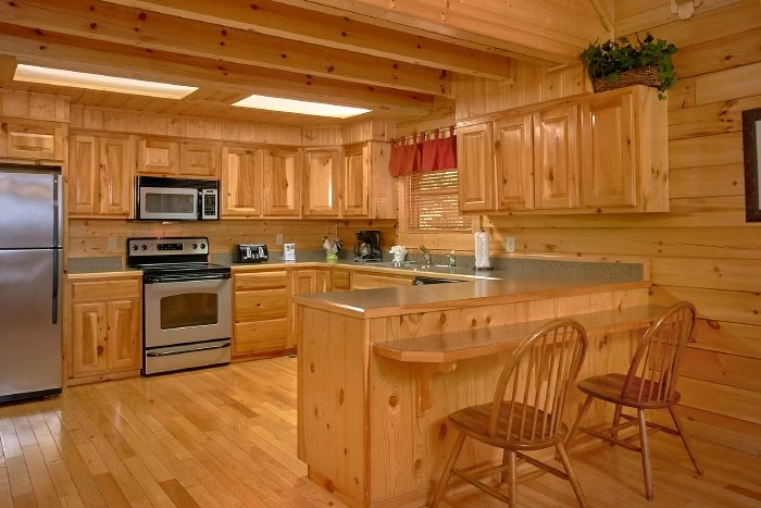 Spacious Kitchen with Bar Seating - Lucky Logs Lodge