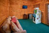 Cabin with arcade game and mini fridge