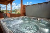 Cabin with oversize hot tub with waterfall