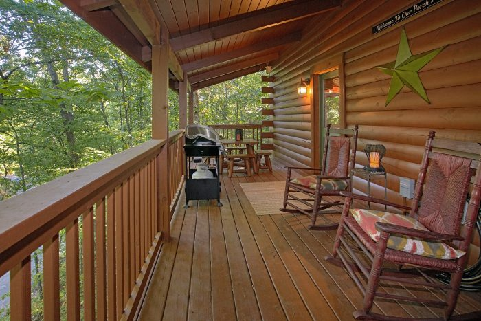 Cabin with a Table on the Deck - Our Happy Place