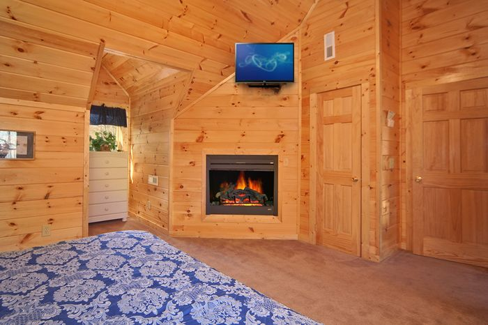 Master Bedroom wtih Fireplace in Cabin - Paws A While