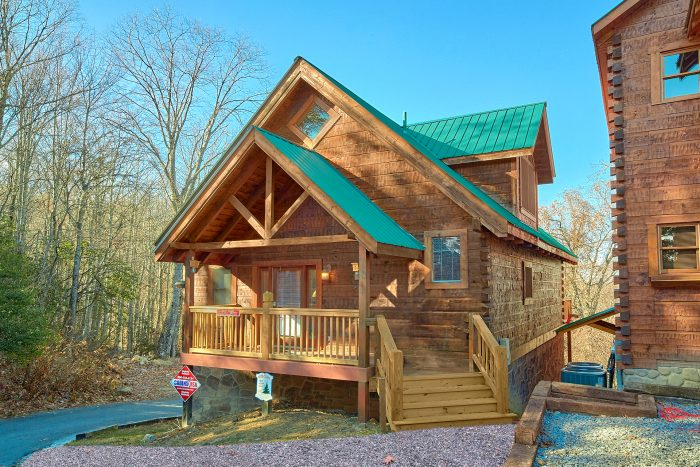 bedroom fishin a cabins hole in rental cabin located gatlinburg rentals