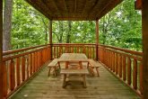 Cabin with picnic table on covered deck
