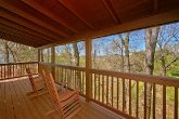 Cabin with Wooded View and Rocking Chairs