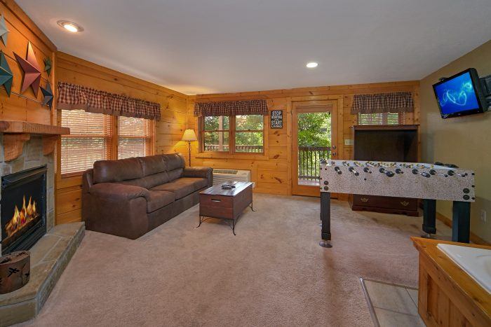 Game room with sleeper sofa, foosball game, and - Southern Deluxe