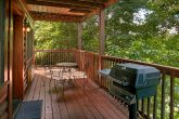 2 bedroom cabin with gas grill on covered deck