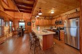 Luxurious Kitchen with Granite Counters in cabin