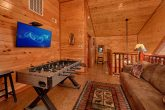 Loft Game Room Area with TV in 2 Bedroom Cabin