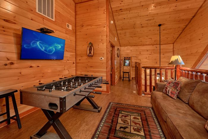 Loft Game Room Area with TV in 2 Bedroom Cabin - Splash Mountain Lodge