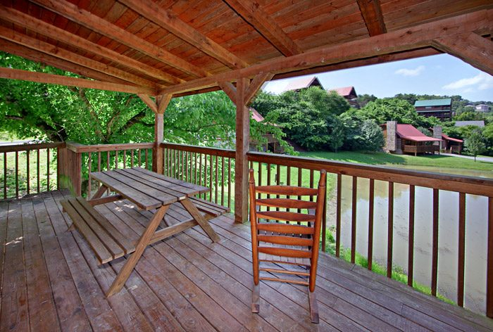 Cabin with Picnic Table on Deck - Tucked Away