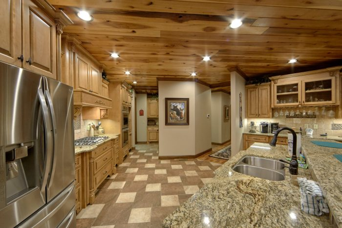 Kitchen with Bar seating and Wine Fridge - Bluff Mountain Lodge