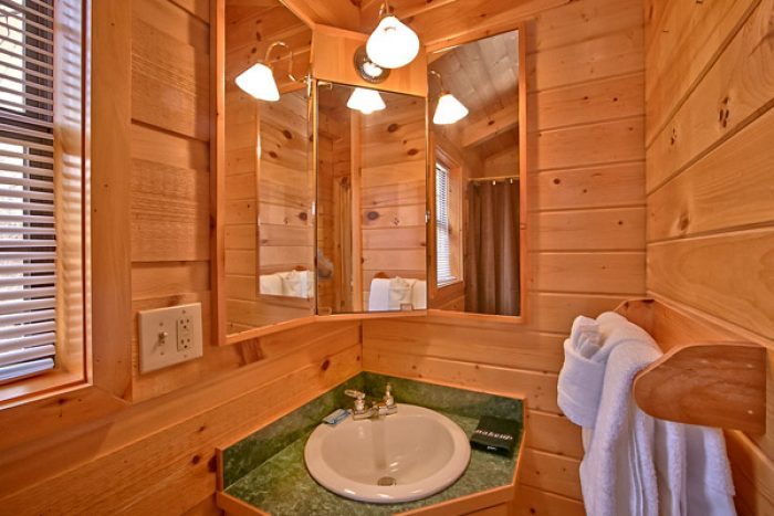 Cabin with lighted bath mirror - Where the Magic Happens